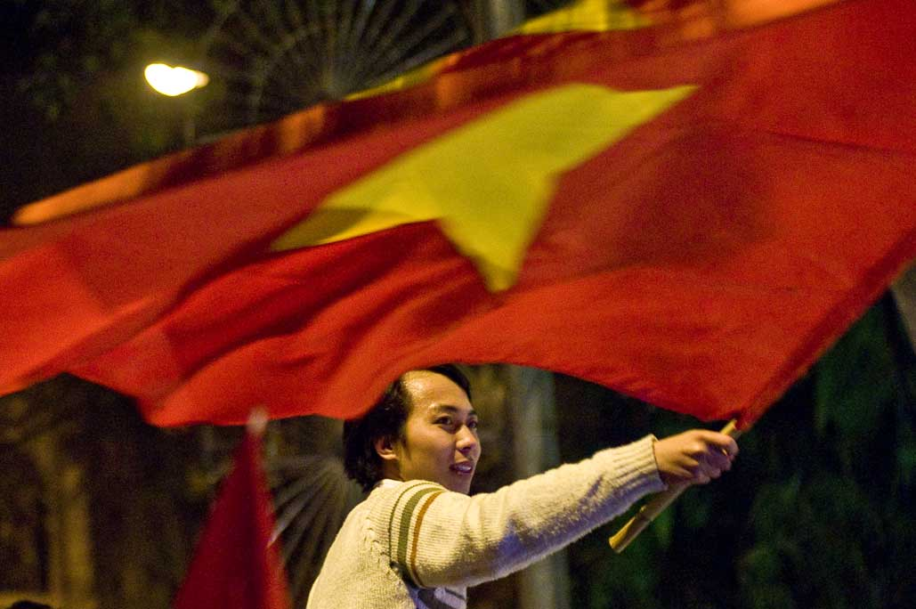image of AARONTAIT COPYRIGHTED 2014 479 VIETNAM GLORY VICTORY FOOTBALL CELEBRATION HANOI FANS PATRIOTISM HAPPY RIOT FLARE DOCUMENTARY REPORTAGE PHOTOGRAPHER