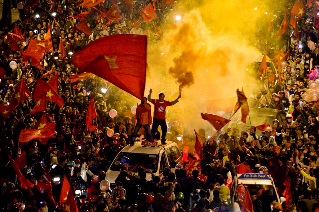 image of AARONTAIT COPYRIGHTED 2014 486 VIETNAM GLORY VICTORY FOOTBALL CELEBRATION HANOI FANS PATRIOTISM HAPPY RIOT FLARE DOCUMENTARY REPORTAGE PHOTOGRAPHER