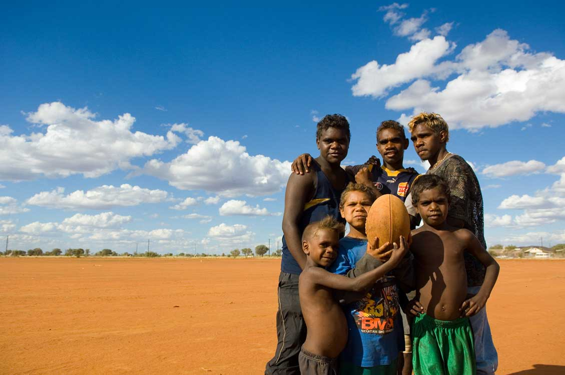 image of AARONTAIT COPYRIGHTED 2014 5372 EDITORIAL DOCUMENTARY PHOTOGRAPHER PAPUNYA NORTHERN TERRITORY AUSTRALIA LANDSCAPE LIFE PEOPLE ART INDIGENOUS PINTUPI LURITJA PAPUNYA TULA PORTRAIT KIDS FOOTBALL AFL TEA
